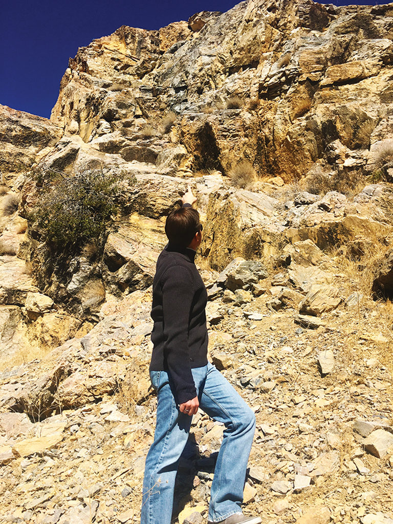 Jerald Simon pointing to the cliff where he (Jerald Simon) fell off in 1988 (Music Motivation - musicmotivation.com)
